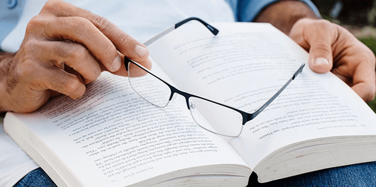 Glasses being held over a book